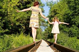 mother and daughter on bridge